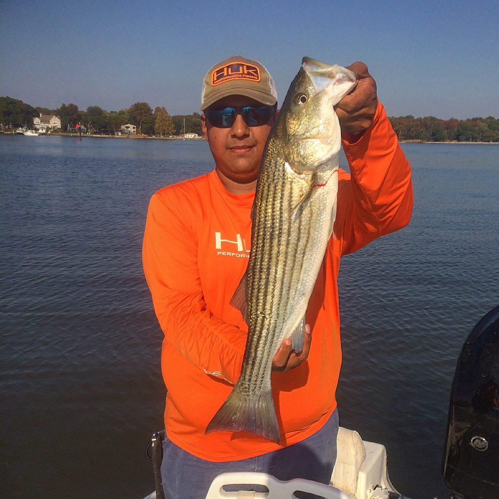 "Alex Perez with a nice 27"" keeper Rockfish"