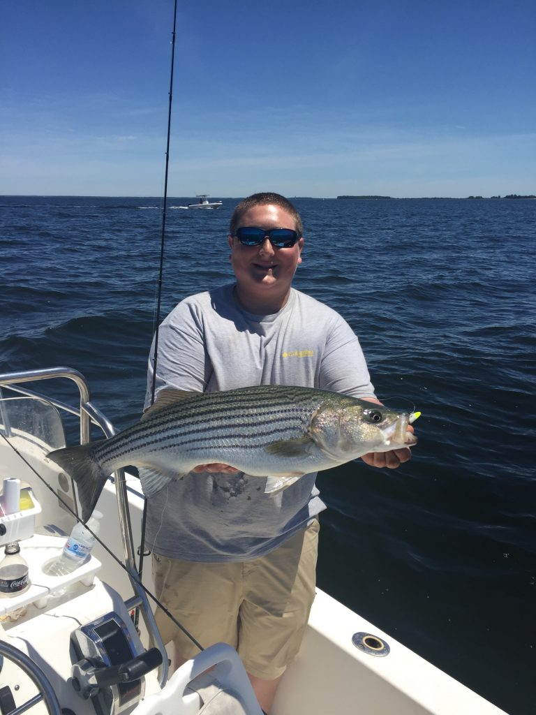 Mike Fiore holds up a nice Rockfish caught yesterday while jigging with light tackle.